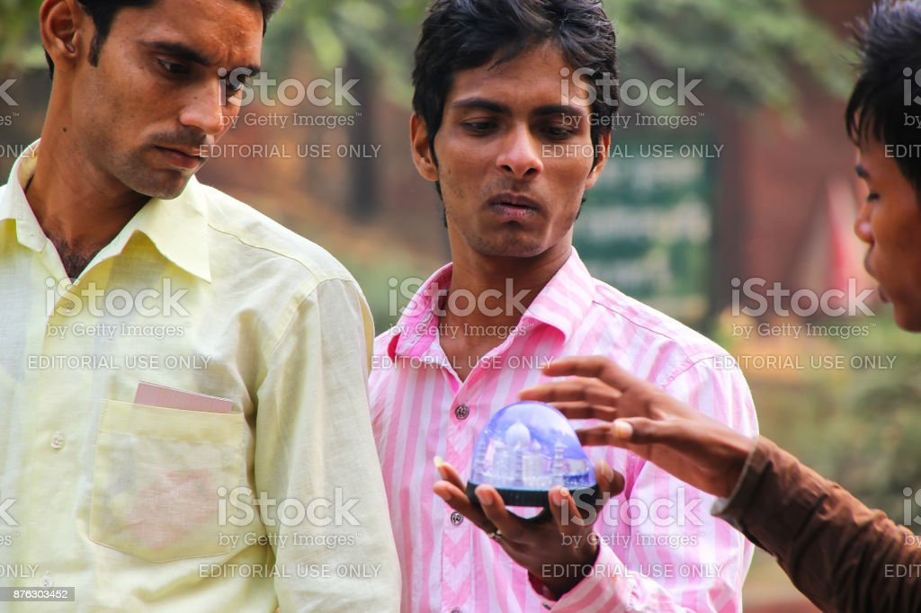 Young men shopping for souvenirs at a small market, Agra stock photo