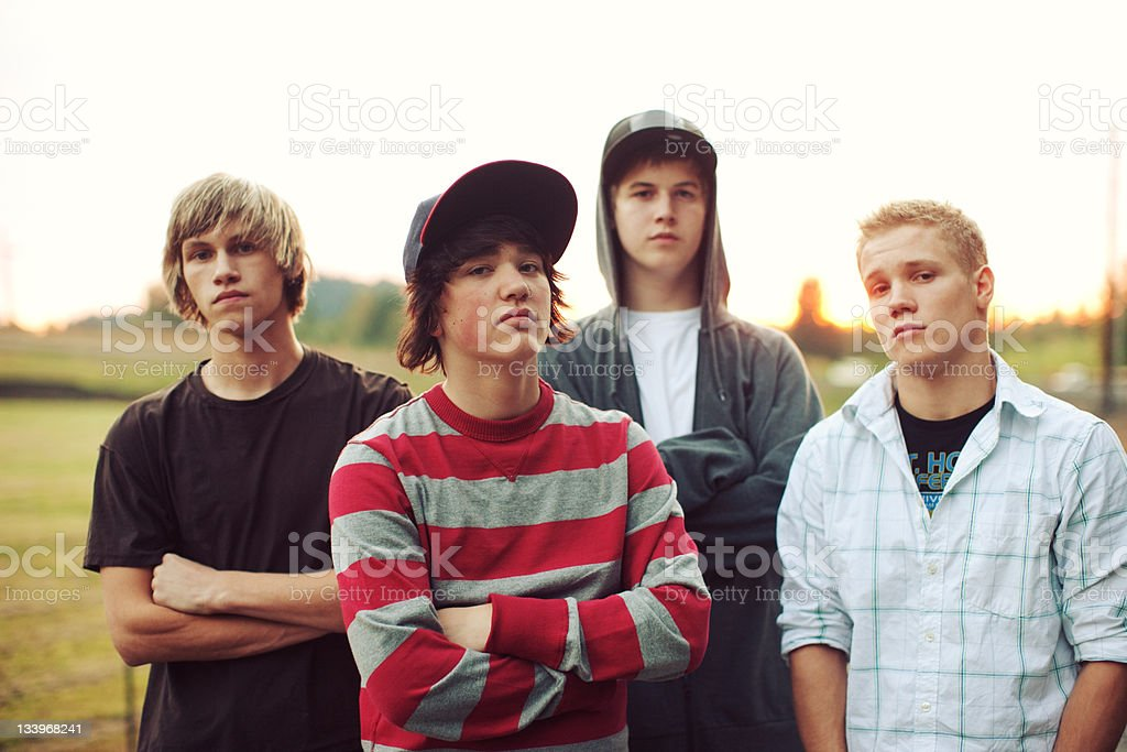 Young Men Sunset Field Group royalty-free stock photo