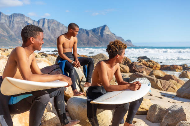 Young Men Surfers Looking at the Waves Before a Surf stock photo