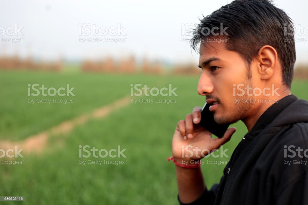 Young men talking on mobile phone stock photo