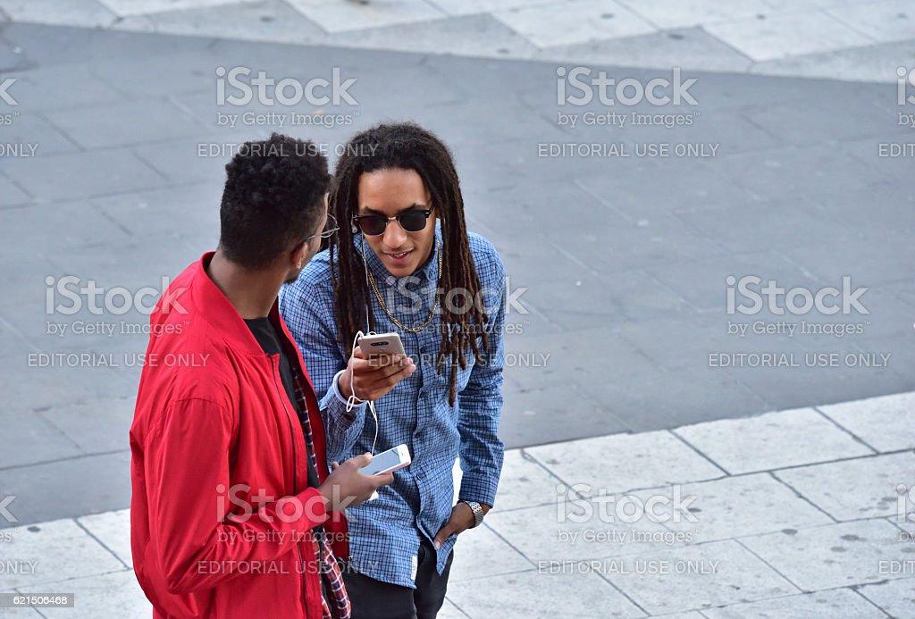 Young men using mobile smart phones Lizenzfreies stock-foto