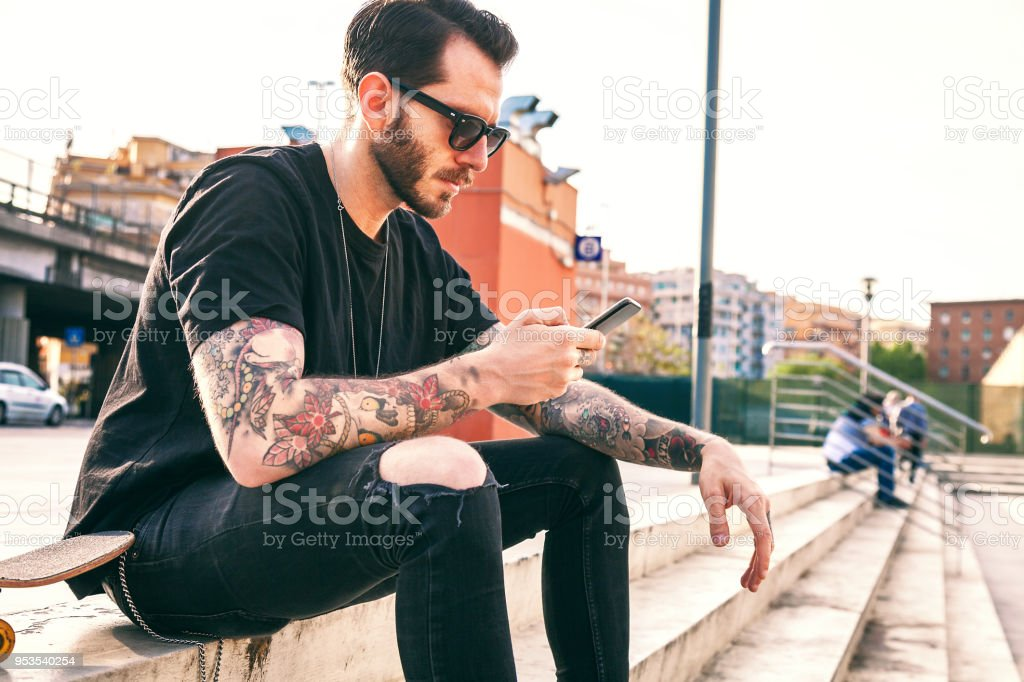 Young Men Using Smartphone stock photo
