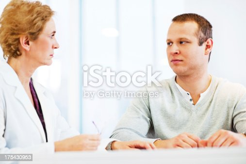 479964946istockphoto Young men visiting a psychologist. 175430953