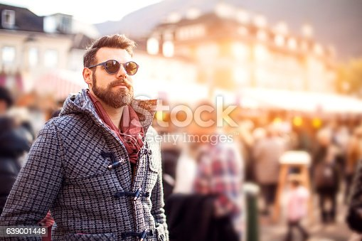 istock Young men walking through city 639001448