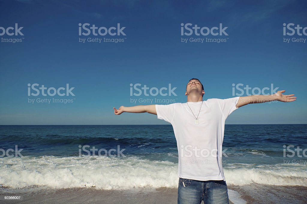 Young Men with extensive openhanded royalty-free stock photo