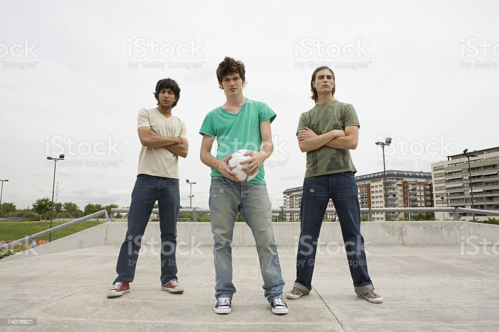 Young men with football stock photo