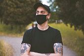 istock Young Men With Mask Outdoors 1225037165