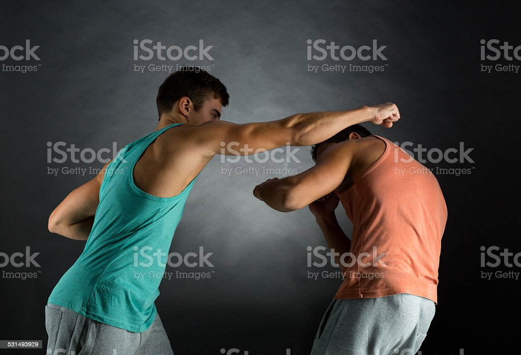 young men wrestling stock photo