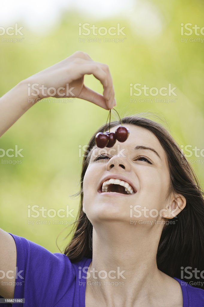young merry woman eating cherries royalty-free stock photo