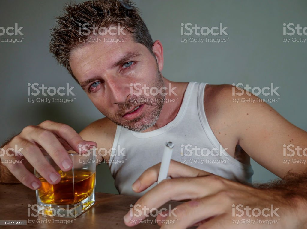 Young Messy And Wasted Addict Man Smoking Cigarette Having