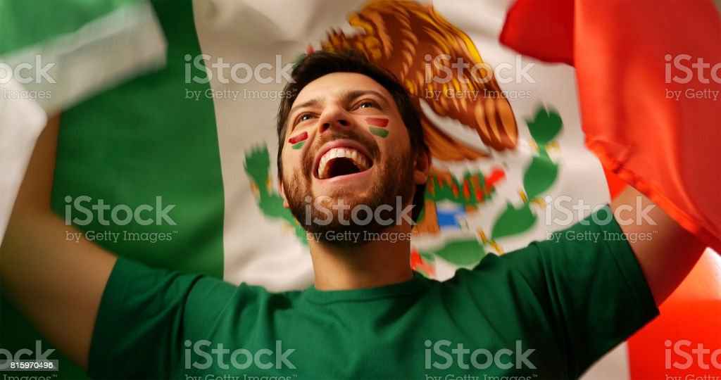 Young mexican fan celebrating stock photo