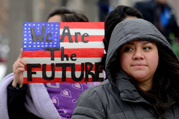Young Mexican immigrants Madison, WI, USA- February 18, 2016 - group of people protesting new Wisconsin immigration laws dane county stock pictures, royalty-free photos & images