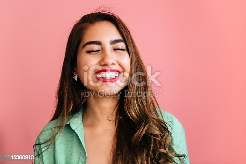 Portrait of Mexican Woman on pink background