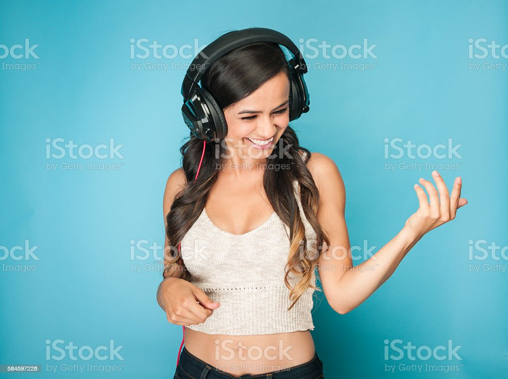 Young Mexican Women Dancing With Headphones stock photo