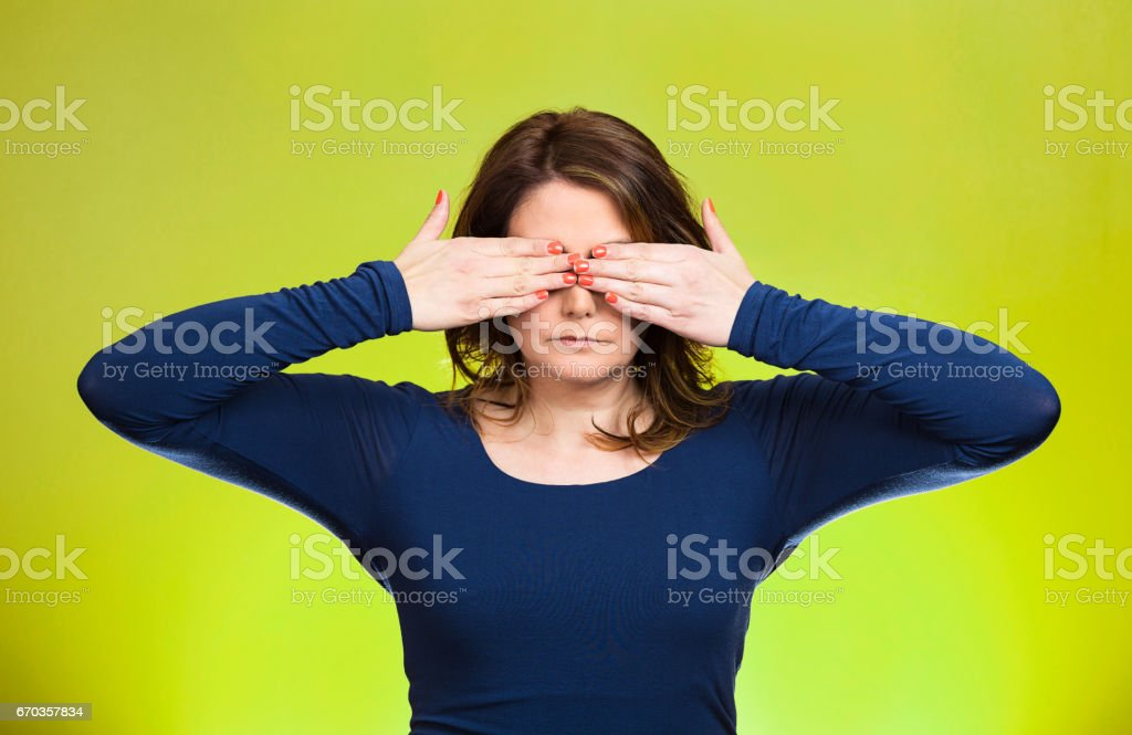 young middle aged woman, closing, covering eyes with hands can't look, hiding, avoiding situation stock photo