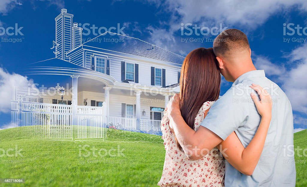 Young Military Couple Facing Ghosted House, Drawing and Grass stock photo