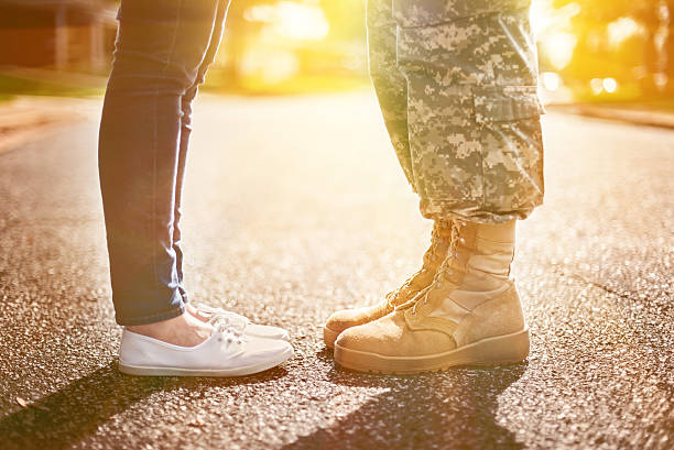 young military couple kissing each other, homecoming concept, so - wife stock photos and pictures