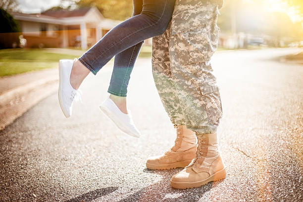 young military couple kissing each other, homecoming concept, wa - wife stock photos and pictures