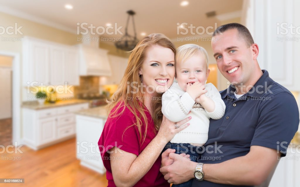 Young Military Family Inside Their Beautiful Kitchen stock photo