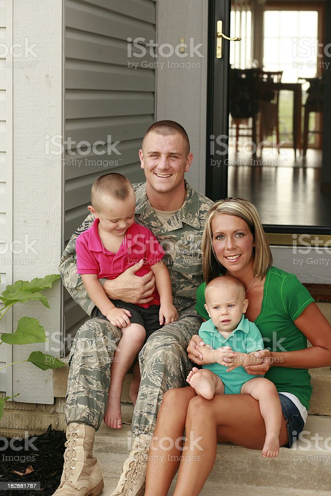 Young Military Family of Four stock photo