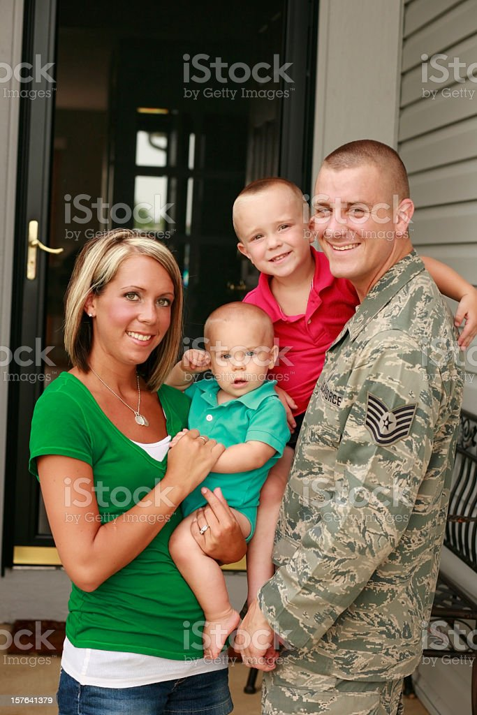 A young military family with two boys stock photo