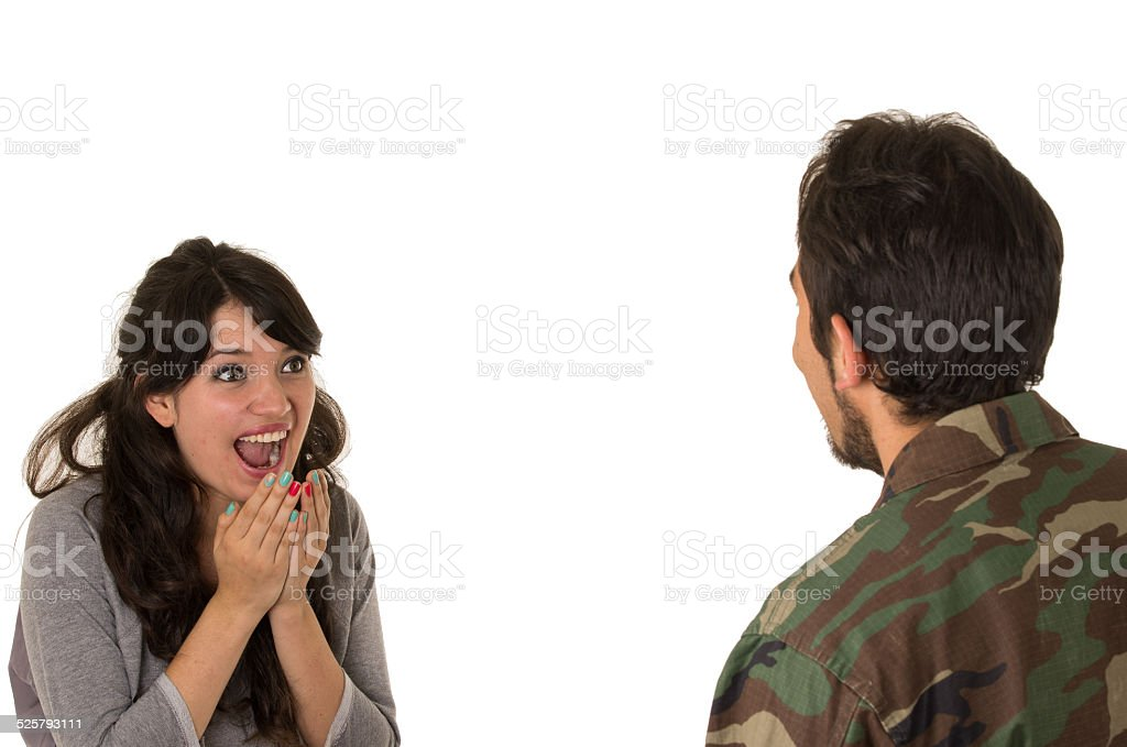 young military soldier returns to meet his wife girlfriend stock photo