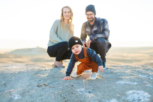 Young Millennial Couple and Boy Child Family Outdoors in Western Colorado Photo Series Winter at Sunset Young Millennial Couple and Boy Child Family Outdoors in Western Colorado Photo Series Matching 4K Video Available (Shot with Canon 5DS 50.6mp photos professionally retouched - Lightroom / Photoshop - original size 5792 x 8688 downsampled as needed for clarity and select focus used for dramatic effect) eyecrave stock pictures, royalty-free photos & images