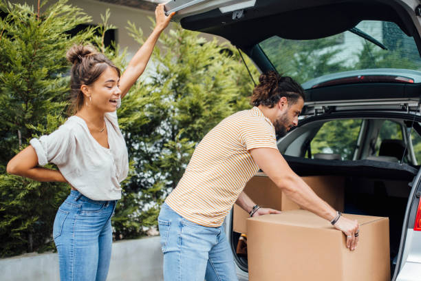Young millennial couple moving stock photo