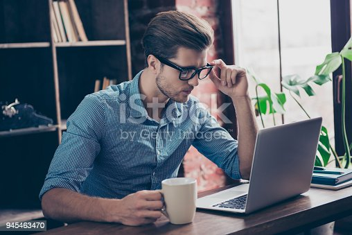 istock Young minded worker drinking tea and thinking about hard task 945463470