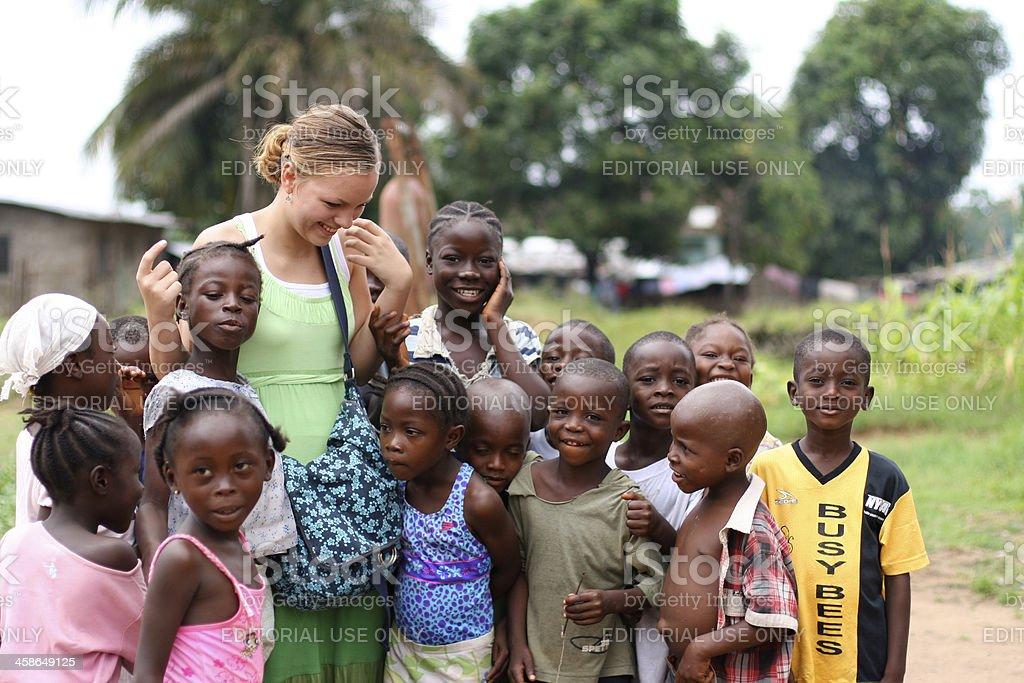 Young Missionary With African Kids stock photo