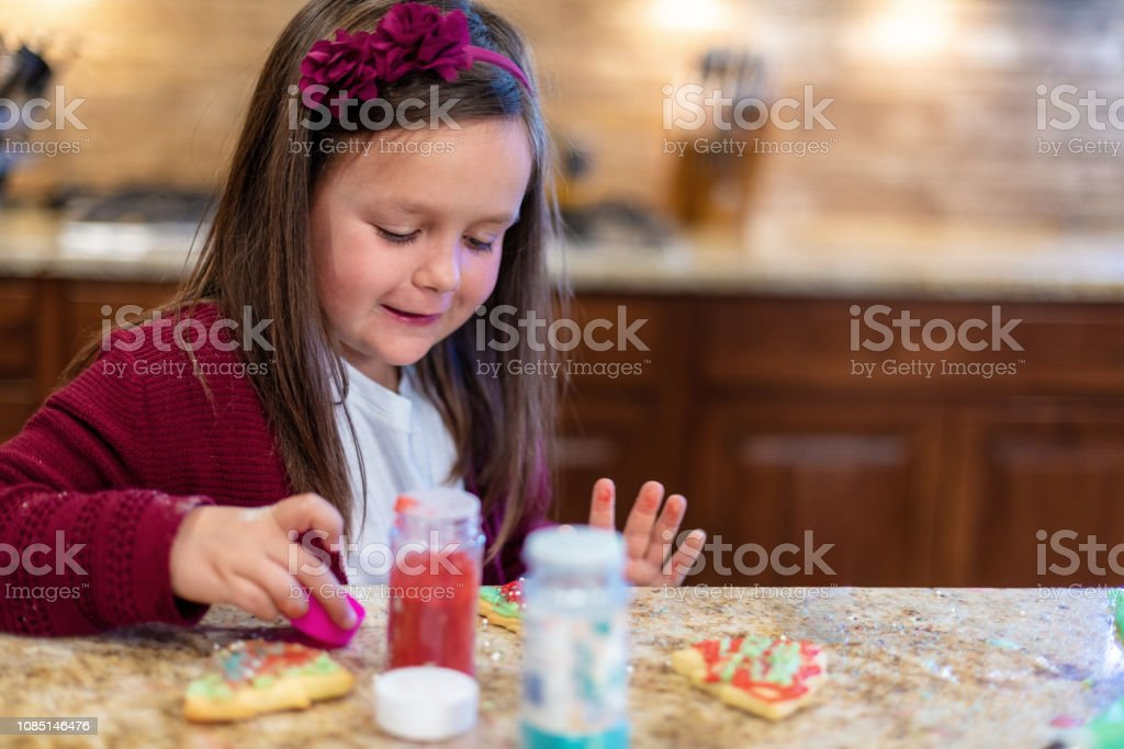 Young Mixed Ethnicity Family Christmas Preparation Baking Cookies...