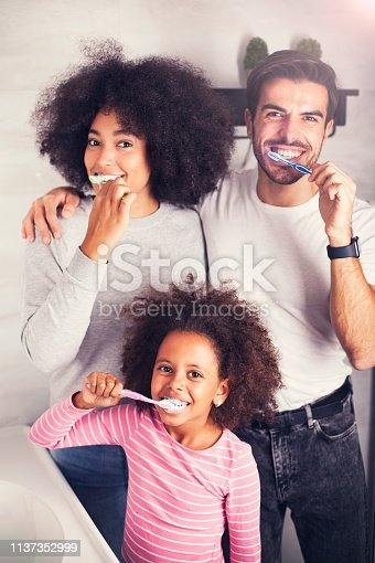 istock Young mixed family are brushing their teeth in the bathroom 1137352999