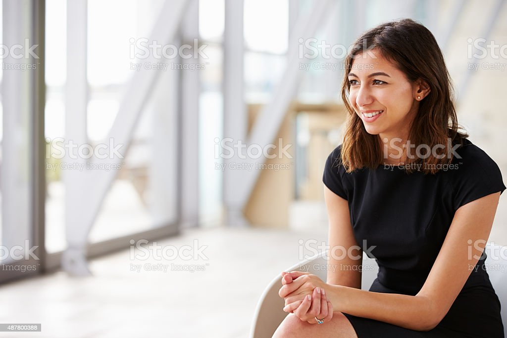 Young mixed race Asian businesswoman looking away stock photo