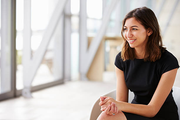 Young mixed race Asian businesswoman looking away Young mixed race Asian businesswoman looking away looking away stock pictures, royalty-free photos & images