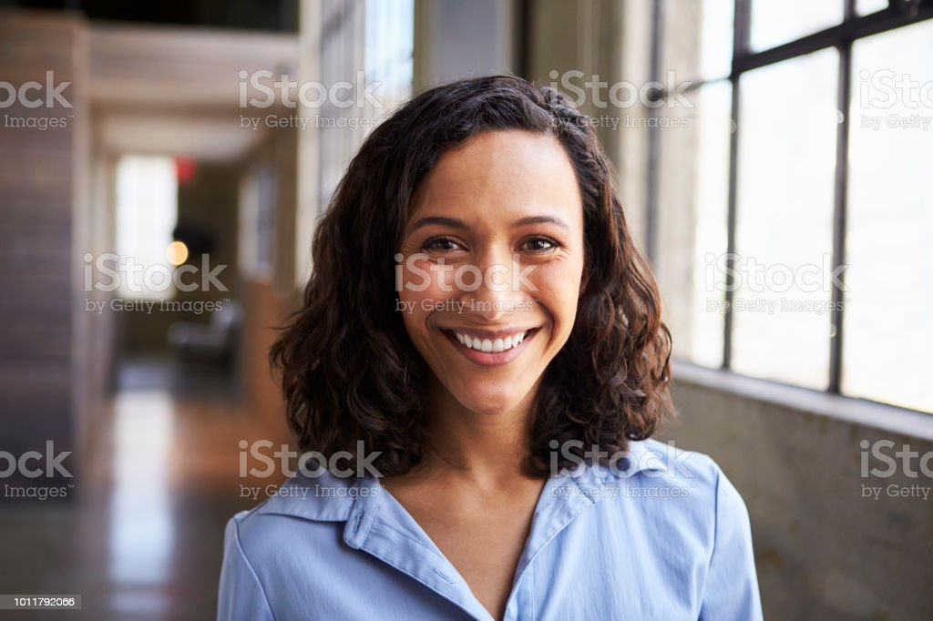 Young mixed race businesswoman smiling to camera stock photo