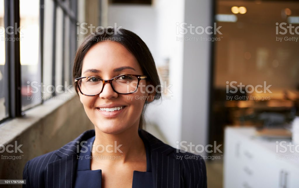 Young mixed race businesswoman wearing glasses, close up stock photo