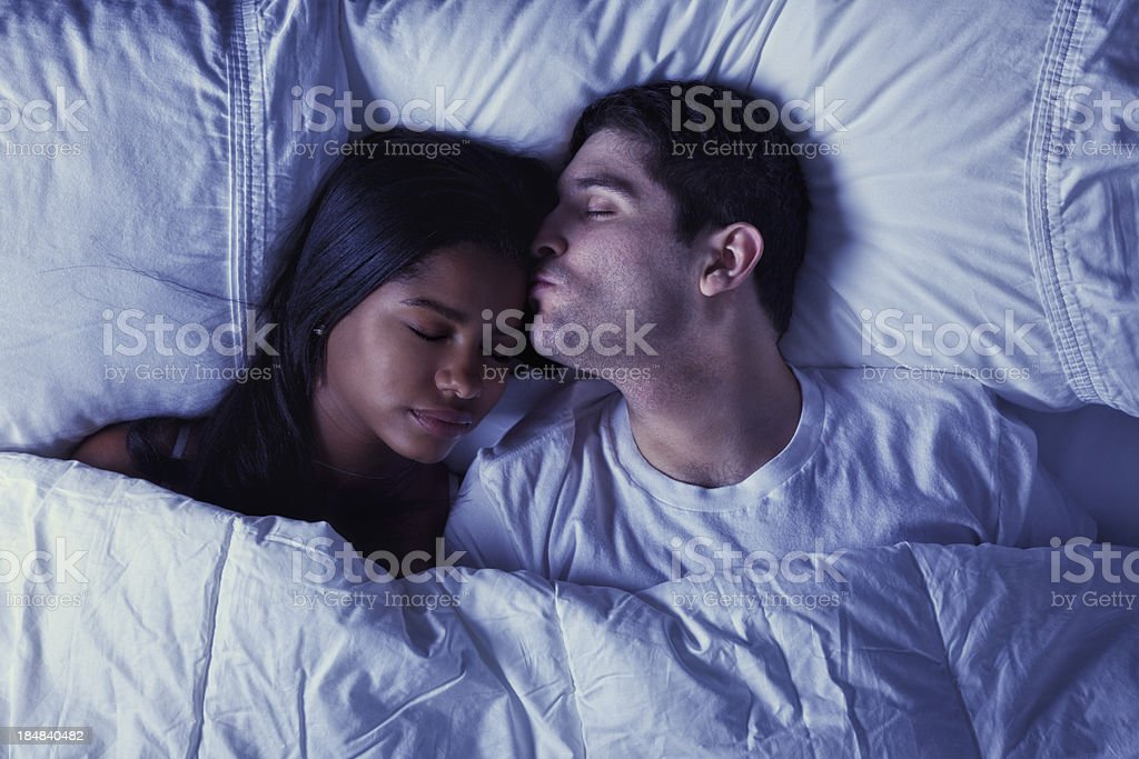 Young Mixed Race Couple in Bed stock photo