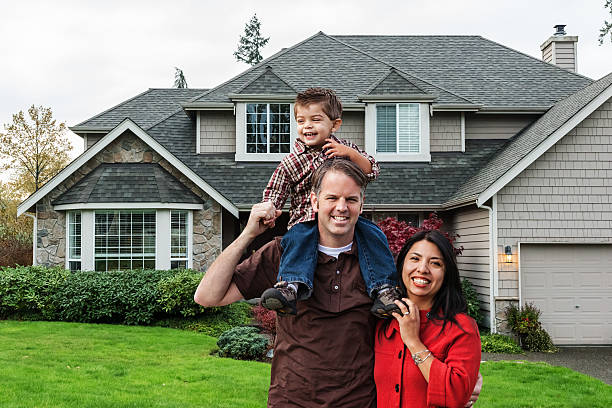 Young Mixed Race Family of Three at Home stock photo