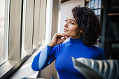 istock Young Mixed Race Woman by the Window 1280797557