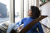 istock Young Mixed Race Woman by the Window 1280797561