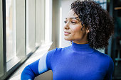 istock Young Mixed Race Woman by the Window 1280797565