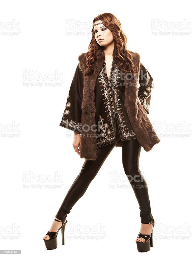 Young model in a black top with embroidery and heels royalty-free stock photo