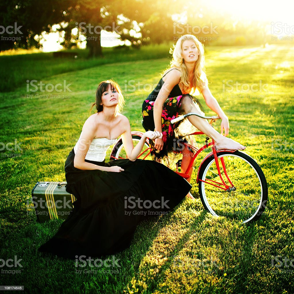 Young Models with a Suitcase and Bike royalty-free stock photo