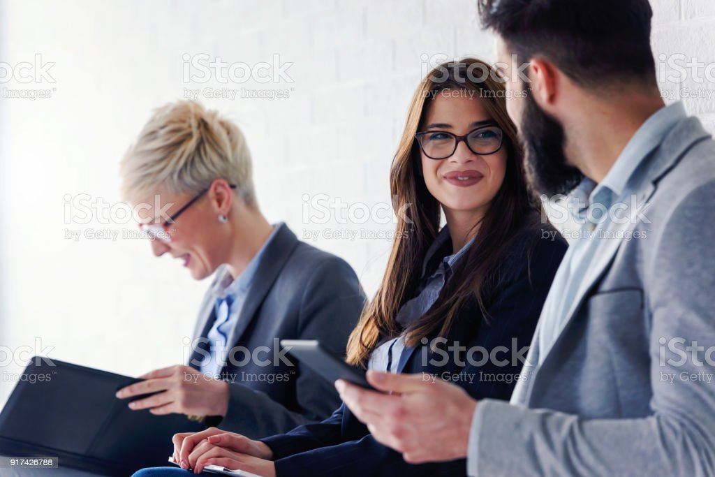 Young modern business people waiting for job interview stock photo