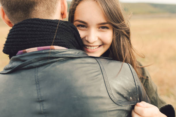 Young modern stylish couple outdoors Young modern stylish couple outdoors. Romantic young couple in love outdoors in the countryside age contrast stock pictures, royalty-free photos & images