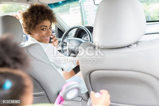 135384905 istock photo Young mom drives daughter to preschool 910238362