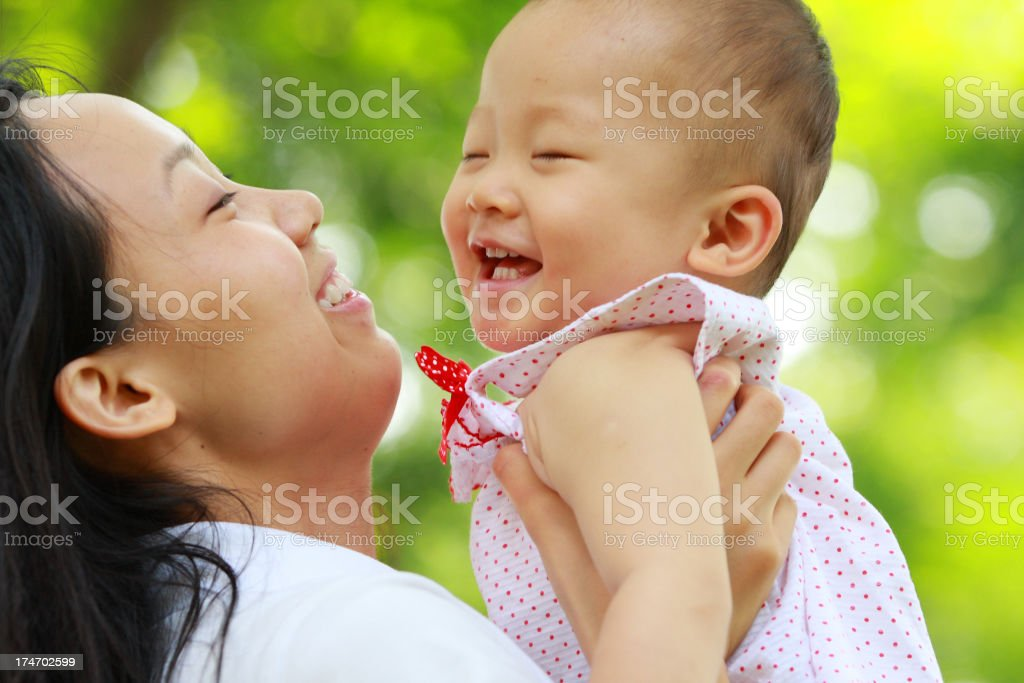 young mom holding her baby royalty-free stock photo