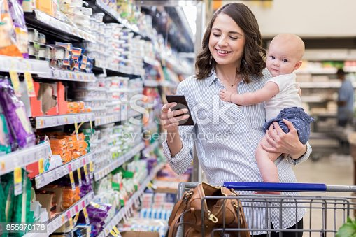 istock Young mom shops with her baby in supermarket 855670178
