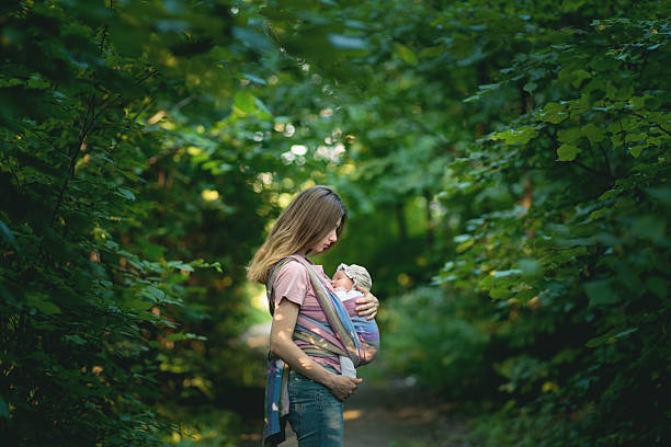 Young Mom with Infant in Sling stock photo