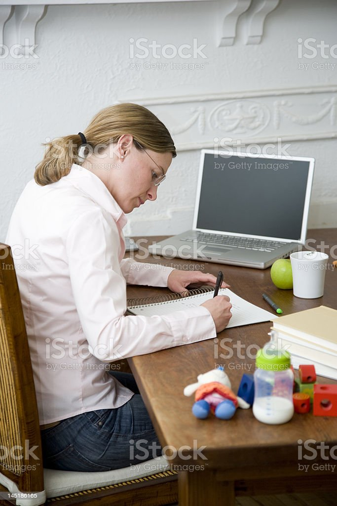 Young mom working from home. royalty-free stock photo